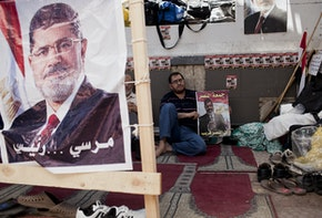 CAIRO, EGYPT - JULY 26: Supporters of deposed Egyptian President Mohammed Morsi sits under a shelter during a demonstration in support of deposed Egyptian President Mohammed Morsi at the Rabaa al-Adweya mosque in the district of Nasr City on July 26, 2013 in Cairo, Egypt. Morsi supporters gathered to protest the overthrow of Morsi, Egypt's first democratically elected leader, by the Egyptian Armed Forces. Muslim Brotherhood leaders called for pro-Morsi protesters to return to the streets on Friday in response to a speech made by General Ahmed Fattah al-Sissi, the Chief of Egypt's Armed Forces, who called for mass anti-Morsi protests across Egypt against 'violence and terrorism' and in support of the military's overthrow of Morsi. (Photo by Ed Giles/Getty Images)