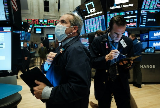 NEW YORK, NEW YORK - MARCH 20: Traders, some in medical masks, work on the floor of the New York Stock Exchange (NYSE) on March 20, 2020 in New York City. Trading on the floor will temporarily become fully electronic starting on Monday to protect employees from spreading the coronavirus. The Dow fell over 500 points on Friday as investors continue to show concerns over COVID-19.  (Photo by Spencer Platt/Getty Images)
