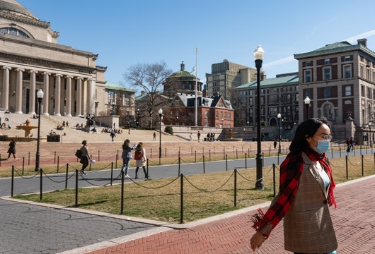 NEW YORK, NY - MARCH 09: A woman wearing a protective mask walks on the Columbia University campus on March 9, 2020 in New York City. The university is canceling classes for two days after a faculty member was quarantined for exposure to the novel coronavirus. The remainder of the week would be taught remotely. (Photo by Jeenah Moon/Getty Images)
