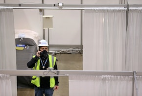 CHICAGO, IL - APRIL 3:  Construction workers put the finishing touches on Hall C Unit 1 of the COVID-19 alternate site at McCormick Place on Friday, April 3, 2020 in Chicago, Illinois. Gov. Pritzker And Mayor Lightfoot toured what will be a 3,000-bed medical facility to treat less seriously-ill COVID-19 patients built in a collaborative effort involving the Illinois National Guard, U.S. Army Corps of Engineers and trade unions.   (Photo by Chris Sweda-Pool via Getty Images)