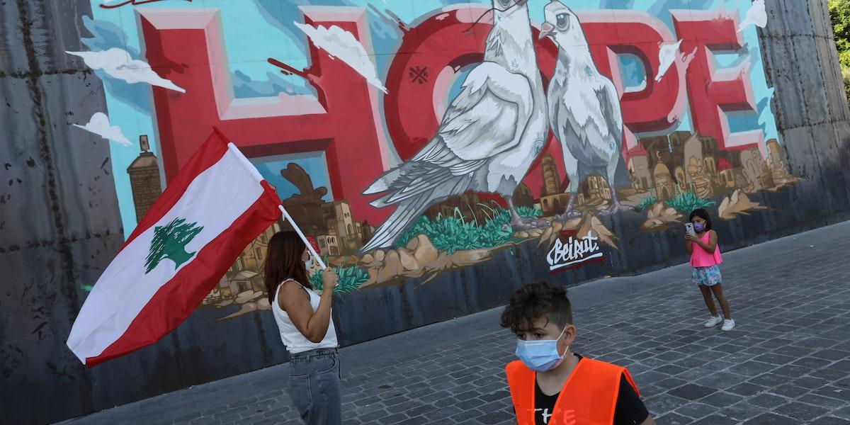 BEIRUT, LEBANON - OCTOBER 17: People walk past a