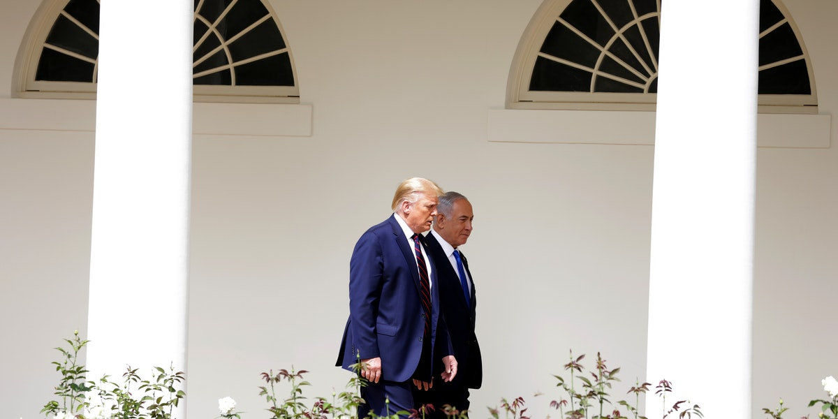 WASHINGTON, DC - SEPTEMBER 15:  Prime Minister of Israel Benjamin Netanyahu and U.S. President Donald Trump walk through the West Wing Colonnade prior to the signing ceremony of the Abraham Accords on the South Lawn of the White House on September 15, 2020 in Washington, DC. Witnessed by President Trump, Prime Minister Netanyahu signed a peace deal with the UAE and a declaration of intent to make peace with Bahrain. (Photo by Alex Wong/Getty Images)