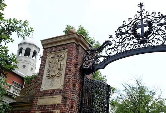 CAMBRIDGE, MASSACHUSETTS - JULY 08: A view of a gate to Harvard Yard on the campus of Harvard University on July 08, 2020 in Cambridge, Massachusetts. Harvard and Massachusetts Institute of Technology have sued the Trump administration for its decision to strip international college students of their visas if all of their courses are held online.  (Photo by Maddie Meyer/Getty Images)