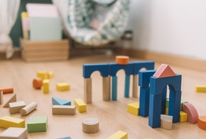 colorful wooden building blocks in the floor at home or kindergarten, educational toys for creative children