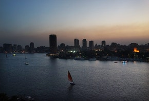 CAIRO, EGYPT - JULY 06: Boats move down the Nile at sunset on July 6, 2013 in Cairo, Egypt. Over 17 people were killed in clashes around the country yesterday with dozens injured as the Egyptian military tries to restore order. Reform leader Mohamed ElBaradei has been named interim prime minister of Egypt. Adly Mansour, chief justice of the Supreme Constitutional Court, was sworn in as the interim head of state in ceremony in Cairo in the morning of July 4, the day after Morsi was placed under house arrest by the Egyptian military and the Constitution was suspended.  (Photo by Spencer Platt/Getty Images)