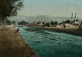 A man sitting by the Barada River in Damascus, Syria, circa 1880. A colorised version of a photograph by Felix Bonfils. (Photo by Hulton Archive/Getty Images)
