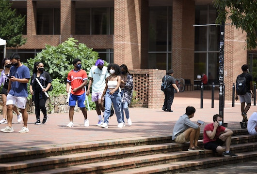 CHAPEL HILL, NC - AUGUST 18: Students walk through the campus of the University of North Carolina at Chapel Hill on August 18, 2020 in Chapel Hill, North Carolina.The school halted in-person classes and reverted back to online courses after a rise in the number of COVID-19 cases over the past week. (Photo by Melissa Sue Gerrits/Getty Images)