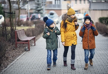 Three kids wearing anti virus masks. Kids are going to school.  Shot with BMPCC4k with Q0 Raw