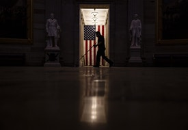 WASHINGTON, DC - JANUARY 07: A worker sweeps up the dust and debris that was left behind by a pro-Trump mob in the Rotunda of the U.S. Capitol building on January 7, 2021 in Washington, DC. Following a rally yesterday with President Donald Trump on the National Mall, a pro-Trump mob stormed and broke into the U.S. Capitol building causing a Joint Session of Congress to delay the certification of President-elect Joe Biden's victory over President Trump. (Photo by Samuel Corum/Getty Images)