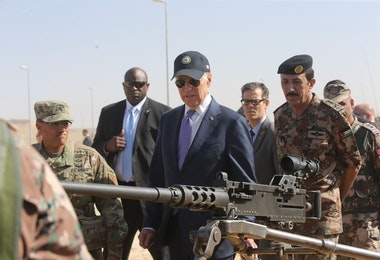ZARQA, JORDAN - MARCH 10: U.S Vice President Joe Biden (C) reviews weapons and troops during a visit with Jordan's King Abdullah (not pictured) at a joint Jordanian-American training center on March 10, 2016 in Zarqa northeast of Amman, Jordan. This is the final stop on Biden's Middle East tour that also took in Israel and the Palestinian territories. (Photo by Jordan Pix/Getty Images)