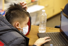 PROVO, UT - FEBRUARY 10: A student works on a computer at Freedom Preparatory Academy on February 10, 2021 in Provo, Utah. Freedom Academy has done in person instruction since the middle of August  of 2020 with only four days of school canceled due to COVID-19 outbreak. (Photo by George Frey/Getty Images)