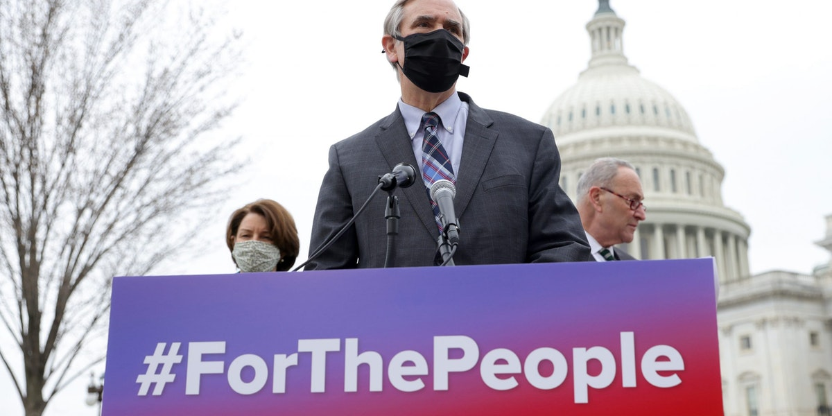 """WASHINGTON, DC - MARCH 17:  Sen. Jeff Merkley (C) (D-OR), Senate Majority Leader Chuck Schumer (R) (D-NY),  and Sen. Amy Klobuchar (L) (D-MN) announce the introduction of S.1., the 'For the People' Act, outside the U.S. Capitol March 17, 2021 in Washington, DC. The """"For the People Act"""" aims to make it simpler for eligible Americans to vote in elections. (Photo by Win McNamee/Getty Images)"""