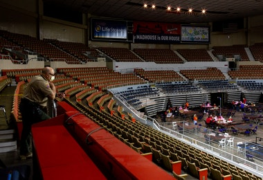 PHOENIX, AZ - MAY 01: An Arizona Rangers watches as contractors working for Cyber Ninjas, who was hired by the Arizona State Senate, examine and recount ballots from the 2020 general election at Veterans Memorial Coliseum on May 1, 2021 in Phoenix, Arizona. The Maricopa County ballot recount comes after two election audits found no evidence of widespread fraud.  (Photo by Courtney Pedroza/Getty Images)