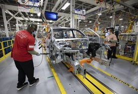 DETROIT, MI - JUNE 10:  Stellantis workers install doors on a 2021 Jeep Grand Cherokee L at the Stellantis Detroit Assembly Complex-Mack on June 10, 2021 in Detroit, Michigan. The plant is the first new auto assembly plant in Detroit in thirty years, and will manufacture the 2021 Jeep Grand Cherokee L. (Photo by Bill Pugliano/Getty Images)