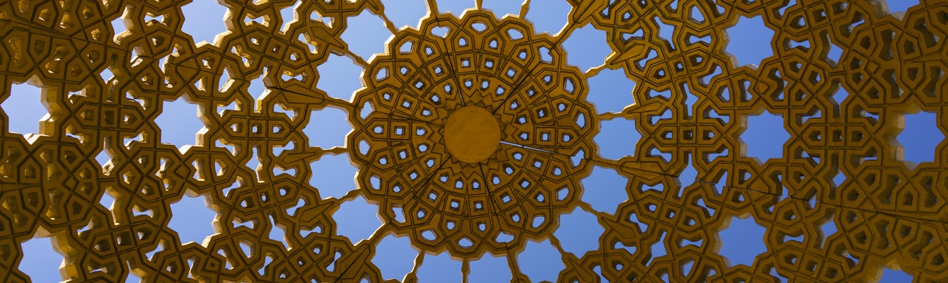 The golden decorative roof of a gazebo on the promenade at Muttrah, Muscat, Oman
