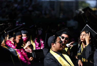 LOS ANGELES, CALIFORNIA - JULY 27: Cal State Los Angeles graduates sit at their commencement ceremony which was held outdoors beneath a tent on campus on July 27, 2021 in Los Angeles, California. Commencement ceremonies for graduates from the classes of 2021 and 2020 are being held outdoors over seven days following delays due to the COVID-19 pandemic.  (Photo by Mario Tama/Getty Images)